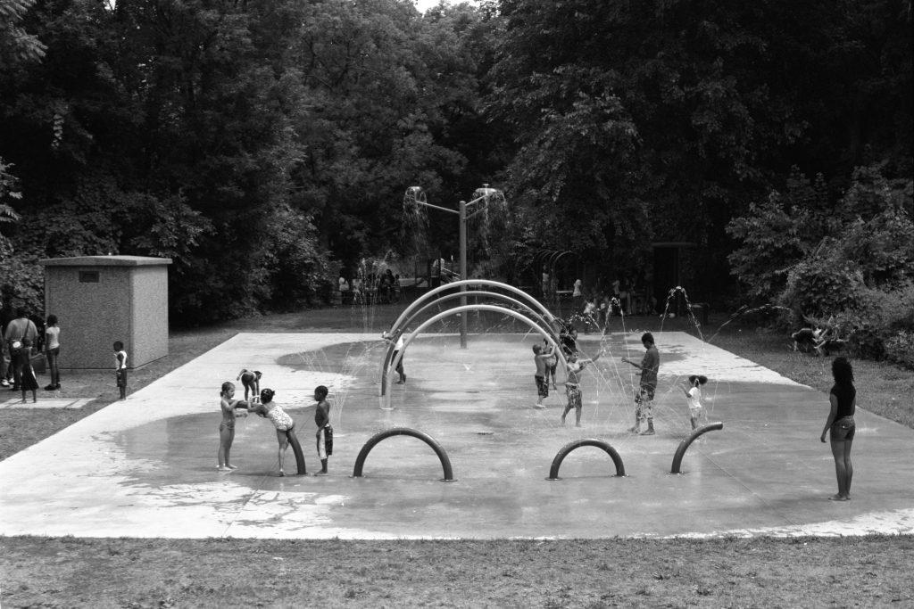 2009: Children play in Sheridan Hollow Splash Park, an environmental amenity drawing summer crowds.