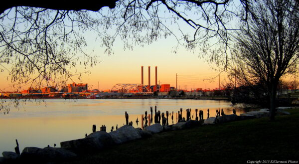 The manufactured nature of India Point Park contrasts with the smokestacks of a nearby power plant in 2013.