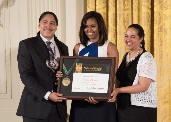 2016: Narragansett community member Christian Hopkin and Tomaquag Museum Director Lorén Spears accept the National Medal for Museum and Library Service from First Lady Michelle Obama.