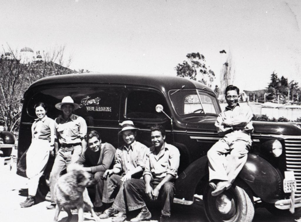 1945: Japanese and Mexican workers gather by a delivery truck for Flower View Gardens.