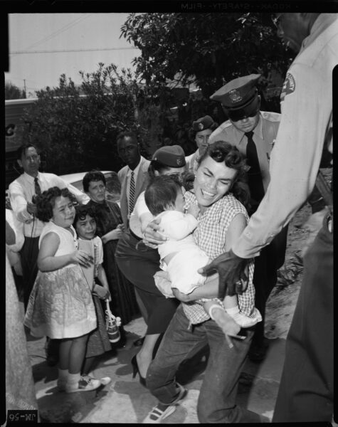 1959: LA Sheriff Deputies carry Aurora Vargas from Chavez Ravine home