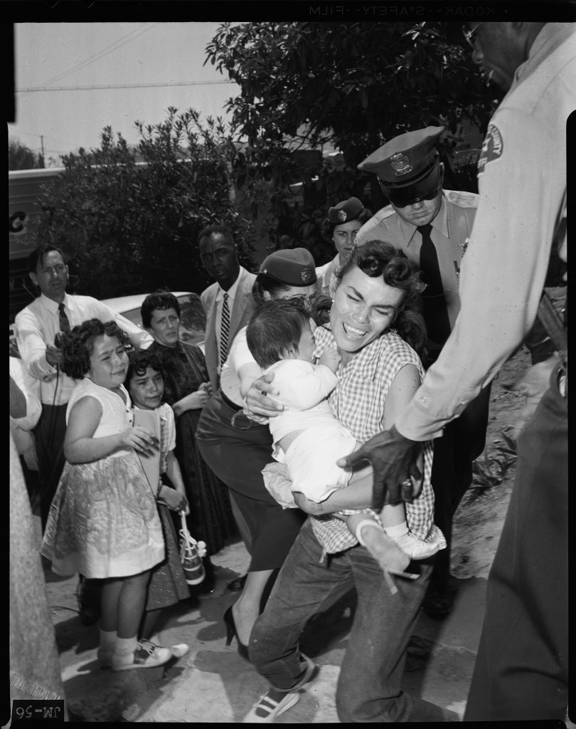 1959: LA Sheriff Deputies carry Aurora Vargas from Chavez Ravine home