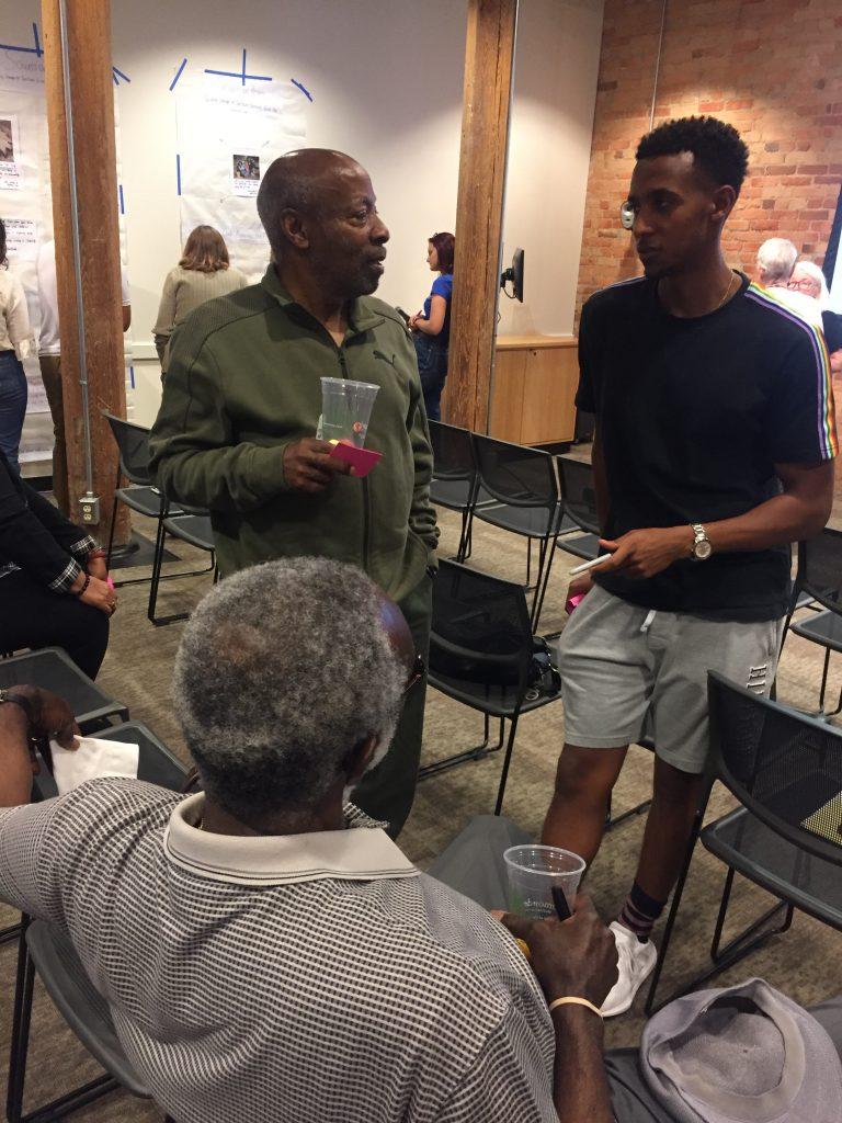 2019: Duke student Surafel Adere, club members Joe Wilson and Paul Lyons discuss gardening and memory.