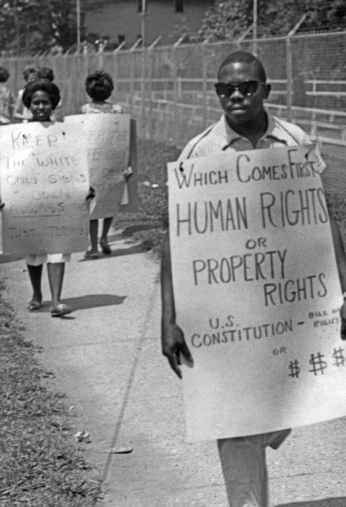 1962: Picketing Riverside Amusement Park; many parks and public pools were segregated, leaving people of color to seek relief from the heat in polluted waterways.