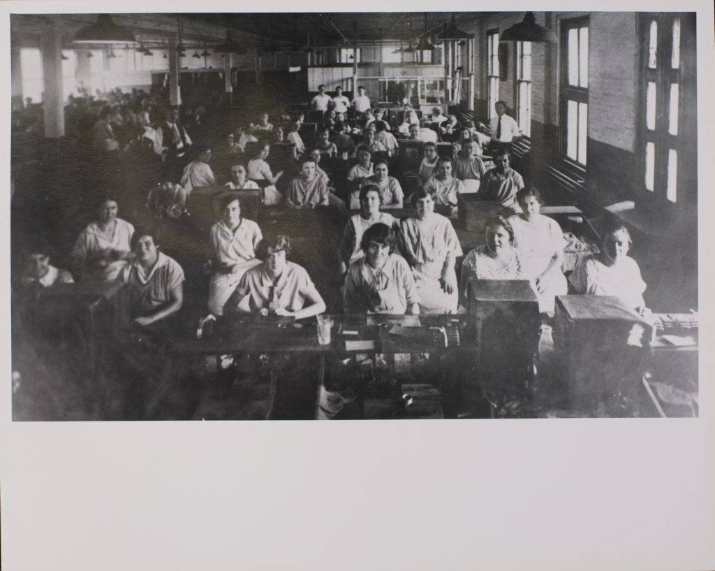 Ca. 1930: Immigrant workers in New Brunswick cigar factory.