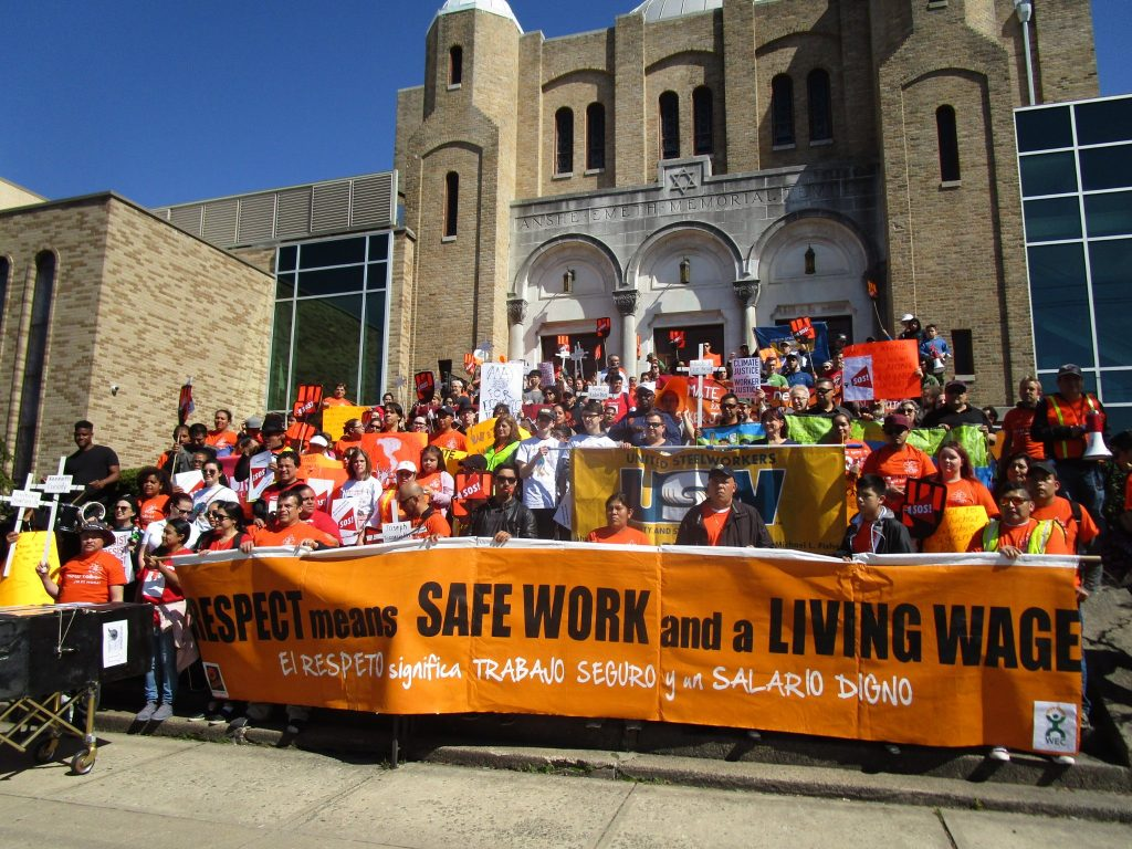 "2018: Immigrant workers in New Brunswick, protesting for ""safe work and a living wage."""