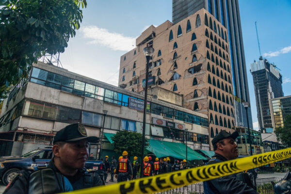 Cops restrict access to damaged office buildings and retail area.