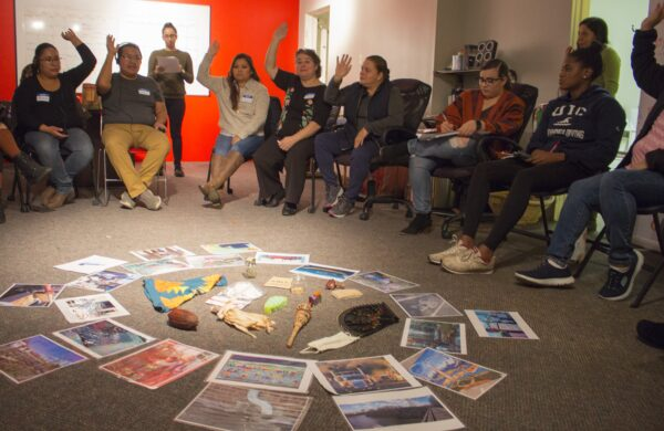 2018: Community members respond to a question during a story circle interview at Alianza Americas.