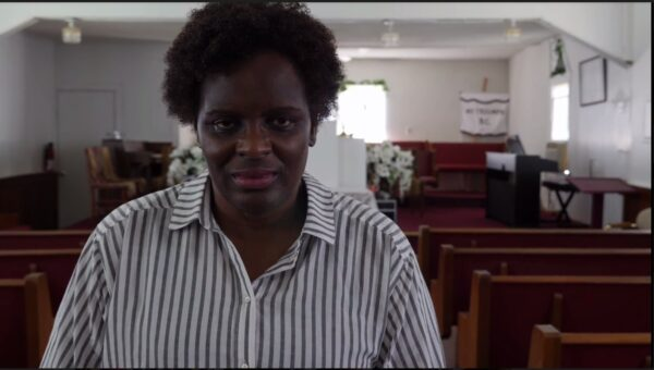 2018: Eve Butler in Mt. Triumph Baptist Church. Still from No Gardens, Women of Cancer Alley.