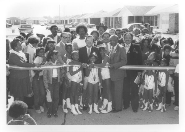 Ca. 1981: Gordon Plaza residents, Mayor Ernest N. Morial (center) and city council people.