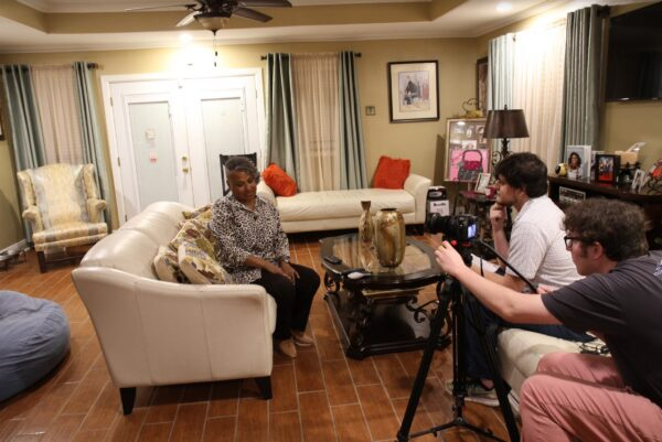 2019: Students interviewing Shannon Rainey, President, Gordon Plaza Resident Association, at home.