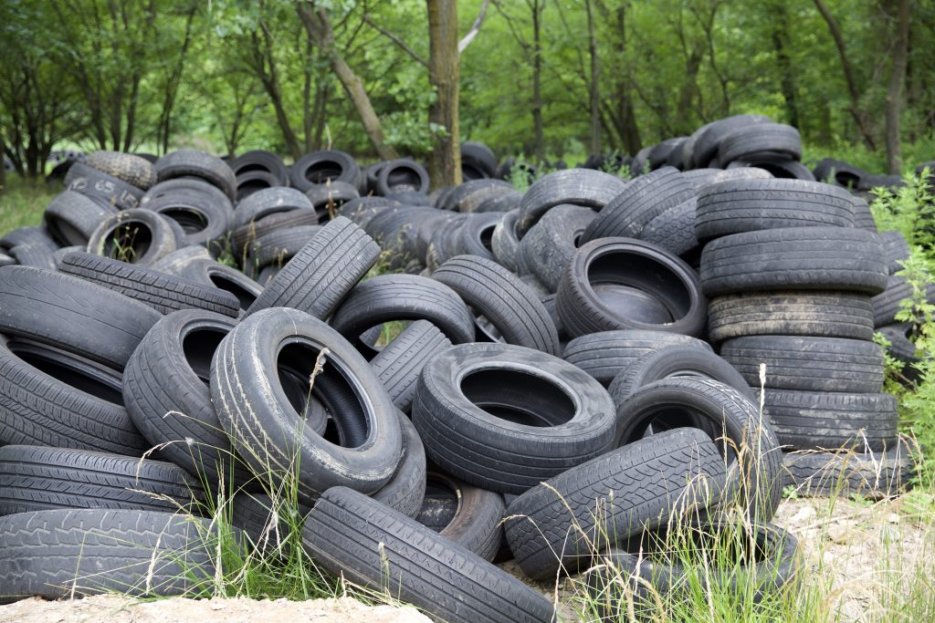 Illegal dumping of hundreds of tires.