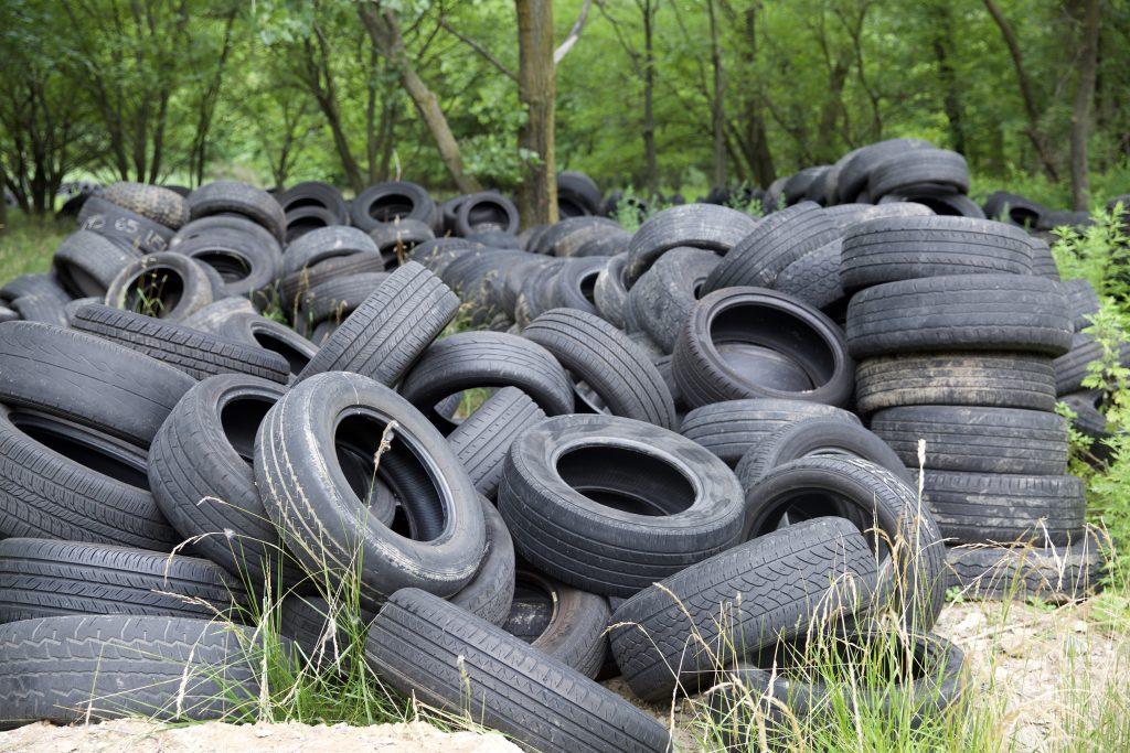 Illegal dumping of hundreds of tires.