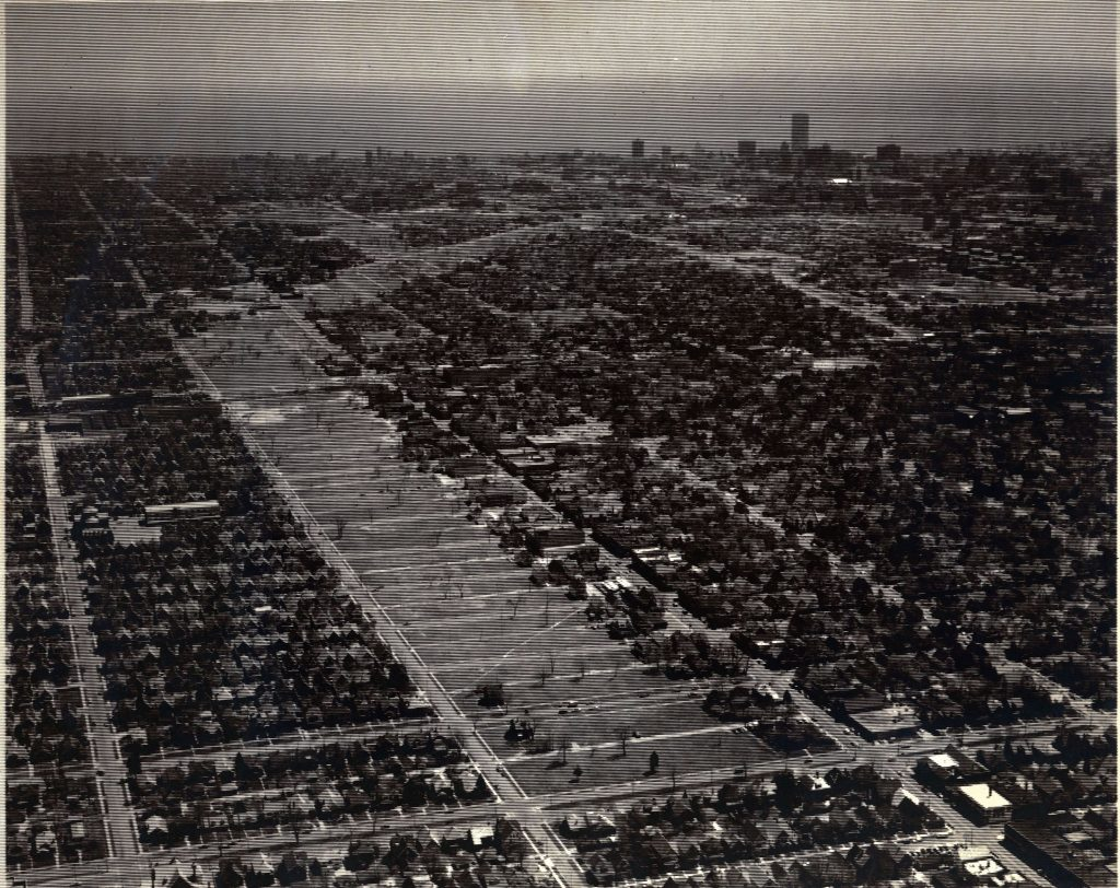 Mid 1970s: Aerial view of a neighborhood demolished to make way for the Park West Freeway, which was never built.